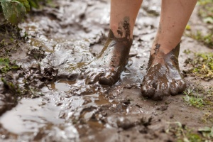 Feet in mud close-up
