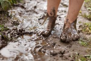 Feet in mud close-up